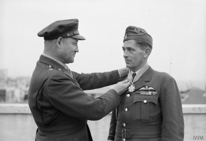 Air Vice Marshal Graham Dawson Director Of Maintenance And Supply Mediterranean Allied Forces Is Presented With The American Legion Merit In